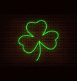 neon green shamrock sign isolated on brick vector image vector image