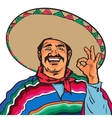 Smiling Mexican man in sombrero and poncho showing vector image