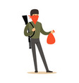 masked robber with rifle on his shoulder carrying vector image vector image
