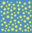 yellow sun pattern on blue background vector image vector image