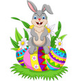 cartoon happy bunny with colorful easter eggs vector image vector image