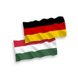 flags of hungary and germany on a white background vector image vector image