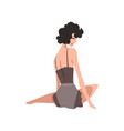 back view of sitting fashion model in black vector image