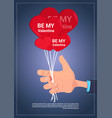 hand holding air balloons with be my valentine vector image