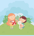 girl and boy with ball and rabbit in meadow vector image vector image