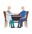 doctor attending old man in table vector image vector image