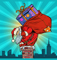 santa claus with bag presents climbing into the vector image