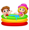 Cartoon boy and girl playing in an inflatable pool