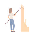 woman painter paints the wall with roller flat vector image vector image