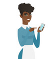 young african cleaner holding a mobile phone vector image vector image