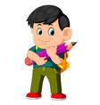 young boy hugging big pencil vector image vector image