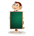 A male monkey holding an empty blackboard vector image vector image