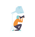 male photographer taking photos using professional vector image vector image
