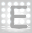 E over lighted background
