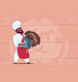 african american chef cook hold turkey smiling vector image vector image