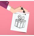 gift box on paper notebook with pencil in hand vector image vector image