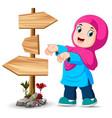 girl is standing beside signpost vector image vector image