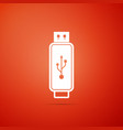 usb flash drive icon isolated on orange background vector image