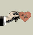 vintage engraving drawing hand holding a red vector image