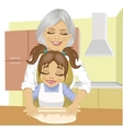 grandmother teaching granddaughter to cook pizza vector image vector image