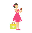 young woman with suitcase wearing in a pink dress
