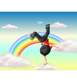 A boy performing a break dance along the rainbow vector image vector image
