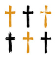 Set of hand-drawn black and yellow grunge cross vector image
