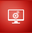 monitor and gears icon isolated on red background vector image vector image