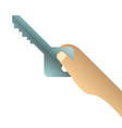 Hand holding key on white background vector image