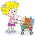 Girl with a shopping trolley of toys vector image