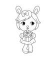 Cute baby rabit girl in dress holding gift box