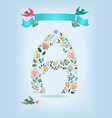 floral letter a with blue ribbon and birds vector image vector image