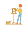 smiling carpenter building a wooden chair vector image vector image