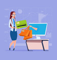 business woman use computer online shopping bag vector image vector image