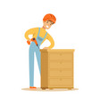 young smiling carpenter man building chest of vector image vector image