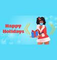 santa woman in mask holding gift box new year vector image vector image