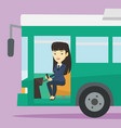asian bus driver sitting at steering wheel vector image vector image