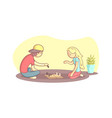 girl and guy sitting on floor and playing vector image vector image