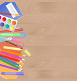 work desk with school supplies set for children vector image