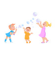 cartoon children play with soap bubbles vector image