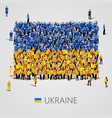 large group of people in the ukraine flag shape vector image vector image