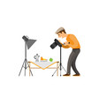 photographer making shot of still life composition vector image vector image
