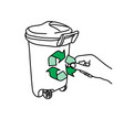 close-up hand holding green recycle sign on trash vector image