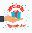 happy friendship day card gift-box in hand palm vector image vector image
