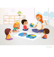 children sit around world map and redhead female vector image vector image