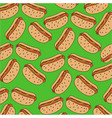 pattern of hot dogs on a green background vector image