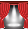 Theater stage with open red curtain and spotlight