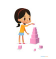 girl with dark hair stands and builds tall pyramid vector image vector image