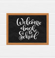 welcome back to school hand-drawn lettering vector image