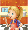 A young girl at the kitchen holding a mixer vector image vector image